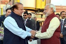 File photo. Prime Minister Narendra Modi (right) shakes hands with Pakistan Prime Minister Nawaz Sharif in Lahore. Photo: AFP/PIB