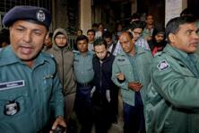 Bangladeshi policemen escort the defendants from a court after the verdict in. Five more secular bloggers and a publisher have been brutally killed this year. Photo: AP