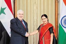 Foreign affairs minister Sushma Swaraj greets Syrian deputy prime minister Walid al-Moualem in New Delhi on Tuesday. Photo: AP