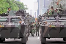 Military armoured personnel carriers parked near the site of the terror attack in Jakarta. Photo: Reuters