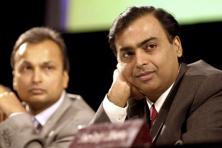 A file photo of Anil Ambani (left) and Mukesh Ambani. Photo: AFP
