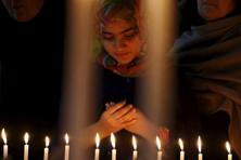 A Girl prays for the victims of a militant attack on the Bacha Khan University, during a candle light vigil in Peshawar on Wednesday. Photo: Reuters