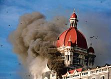A file photo of Taj Hotel in Mumbai. Smoke belching out from below the main dom. Photo: Hindustan Times