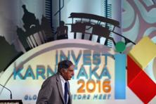Tata Group chairman Ratan Tata leaves after addressing the 'Invest Karnataka 2016-Global Investors Meet' in Bangalore. Photo: AP