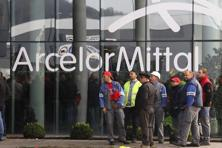 A file photo of Arcelormittal Steel workers waiting outside the company's regional headquarters in Belgium. The company, twice the size of its nearest rival, reported that its core profit dropped by 32% last year. Photo: Reuters