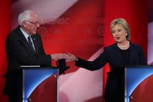 Democratic presidential candidates former secretary of state Hillary Clinton (right) and US Senator Bernie Sanders shake hands during their MSNBC Democratic Candidates Debate at the University of New Hampshire on Thursday in Durham, New Hampshire. Photo: AFP