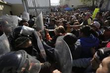 Family members of inmates clash with Police blocking the entrance of the Topo Chico prison in Monterrey. Photo: Reuters