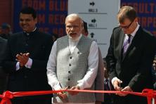 Prime Minister Narendra Modi (centre) cuts a ribbon as Finnish Prime Minister Juha Sipila (right) and Maharashtra chief minister Devendra Fadanvis look on during the opening of the 'Make in India Week' in Mumbai. Photo: AFP