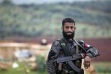 A file photo shows a Syrian soldier keeping watch near Maarzaf, about 15 kilometers west of Hama, Syria. Photo: AP