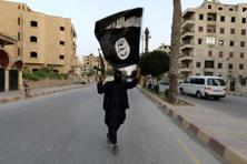 A member loyal to the Islamic state waves an Islamic state flag in Raqqa. Photo: Reuters