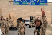 Pro-government Syrian force gesture as they advance into the historic city of Palmyra in this picture provided by Sana on 24 March 2016. Photo: Reuter