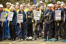 A file photo shows steelworkers waiting for British business secretary Sajid Javid (not pictured) to leave Tata Steel's steel plant in Port Talbot on Friday. Photo: AFP