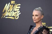 Charlize Theron arrives at the MTV Movie Awards at Warner Bros. Studios. Photo: Reuters