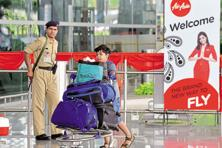 In April 2013, AirAsia Bhd signed a brand licence agreement with AirAsia India, mandating the latter's compliance with the Malaysian airline's requirements in just about every area—from branding and in-flight services to engineering and finance. Photo: AFP