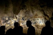 People look at the full-scale reproduction of frescos found at the cave of Pont-D'Arc also known as the Chauvet cave, on 8 April 2015 in Vallon Pont D'Arc. Photo: AFP