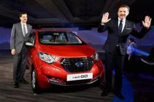 Nissan Motor India managing director Arun Malhotra and the company's president Guillaume Sicard pose with the Datsun redi-GO car at its launch in New Delhi on Thursday. Photo: PTI