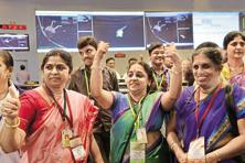 Isro's female scientists celebrate after the success of the Mars Orbiter Mission on 24 September 2014. Women account for only 20% of the space agency's total workforce. Photo: AFP