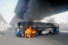 A file photo of a bus set on fire by workers protesting against changes in provident fund rules, in Bengaluru. Photo: AFP