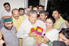 Former Uttarakhand chief minister Harish Rawat with Congress supporters in Dehradun on Thursday.. Photo: PTI