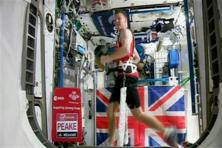 British astronaut Tim Peake in action running the London marathon while strapped to a treadmill to counter the lack of gravity at the International Space Station. Photo: AP