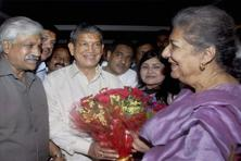 Uttarakhand Congress in-charge Ambika Soni presents a bouquet to chief minister Harish Rawat during a meeting in Dehradun on Friday. Photo: PTI