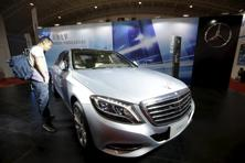 A visitor looks at a Mercedes-Benz S500 eL plug-in hybrid car during the Auto China 2016 in Beijing on 25 April. Photo: Reuters