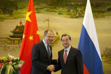 Russian foreign minister, Sergey Lavrov (left) and Chinese foreign minister Wang Yi shakes hands after a joint press conference held at the Chinese foreign ministry in Beijing, China, on 29 April 2016. Photo: AP