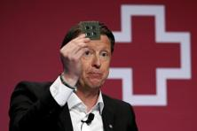A file photo shows Ericsson CEO Hans Vestberg, who thinks 5G could provide an opportunity to transform the world, showing a 5G chip at the Mobile World Congress. Photo: Reuters