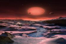 The artist's impression shows an imagined view from the surface of one of the three planets orbiting an ultracool dwarf star just 40 light-years from earth that were discovered using the TRAPPIST telescope at La Silla Observatory. Photo: AP