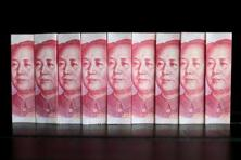 China only allows the yuan to rise or fall 2% on either side of the daily fix, one of the ways it maintains control over the currency. Photo: Reuters