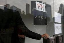 A file photo of an Uber office in Hong Kong. Didi Kuaidi and Uber are competing for pre-eminence in China as the ride-hailing market surges. Photo: Reuters