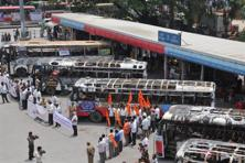 Charred buses on display at the KSRTC bus stand as part of a public awareness campaign 'It's My Bus' in Bengaluru on Tuesday. Photo: PTI