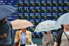 Japanese shares climbed as the yen nursed last session's retreat against the dollar, with US crude holding around a six-month high and continued gains in industrial metals bolstering investors' appetite for risk. Photo: AFP