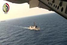 A screengrab from a video image released by the Egyptian defence ministry shows a plane over an Egyptian ship during the search in the Mediterranean Sea for the missing EgyptAir plane. Photo: AP