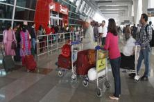 Passengers waiting to board their flight outsdie Terminal 3 of Delhi airport. Photo: Sunil Saxena/Hindustan Times