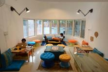 Construkt has a dizzying medley of colour in the lounge and dining area, and a lot of the furniture is recycled or upcycled. Photo: Hemant Mishra/Mint