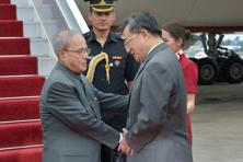 President Pranab Mukherjee was received by China's foreign affairs vice minister Liu Zhenmin upon his arrival at Guangzhou in China on Tuesday. Photo: PTI