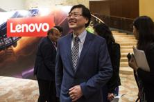 Yang Yuanqing, chairman and CEO of Lenovo Group Ltd., center, arrives at a news conference in Hong Kong. Photo: Justin Chin/Bloomberg