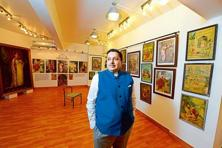 Shivaswamy with his lithograph collection at Gallery G. Photo: Hemant Mishra/Mint