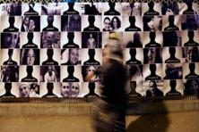 A file photo shows a woman passing by photos of the victims of Egyptair crash. Photo: Reuters
