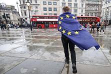A demonstrator wrapped in a European flag leaves an anti-Brexit protest in Trafalgar Square in central London on Tuesday. Photo: AFP