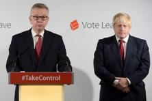 A file photo of Britain's justice secretary Michael Gove (Left) who speaks as Vote Leave campaign leader Boris Johnson listens at the group's headquarters in London. Photo: Reuters