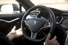 New autopilot features are demonstrated in a Tesla Model S during a Tesla event in Palo Alto, California. Photo: Reuters