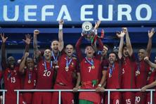 Portugal lifts the trophy after winning the Euro 2016 final football match against France at the Stade de France in Saint-Denis on 10 July. Photo: AFP