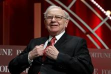 Warren Buffett made a pledge in 2006 to hand over a total that equates to 500 million shares, and each year he gives 5% of the remaining total. Photo: Reuters