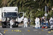 Investigators near the heavy truck that ran into a crowd at high speed killing scores who were celebrating the Bastille Day 14 July national holiday on the Promenade des Anglais in Nice, France. Photo: Eric Gaillard/Reuters