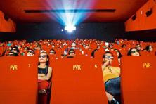 A file photo of people watching a movie at a PVR multiplex in Mumbai. Photo: Reuters