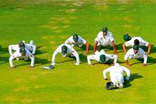 Team Pakistan doing push-ups. Photo: Andrew Boyers/Reuters