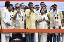 West Bengal chief minister Mamata Banerjee is singing National Anthem with others during 'Shahid Diwas' rally in Kolkata on Thursday. Photo: PTI