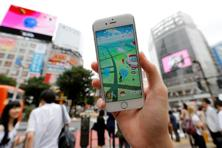 A man with his mobile phone displaying the augmented reality mobile game 'Pokemon Go' by Nintendo in front of a busy crossing in Shibuya district in Tokyo, Japan. Photo: Toru Hanai/Reuters